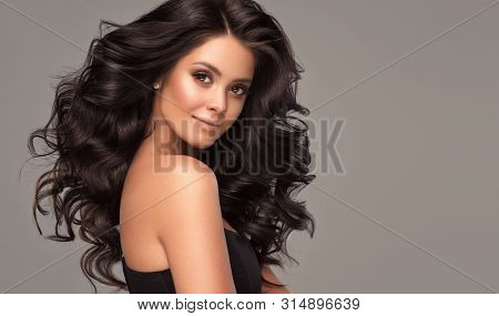 poster of Beauty Brunette Girl With Long  And   Shiny Wavy Black Hair .  Beautiful   Woman Model With Curly Ha