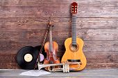 Retro Musical Instruments On Wooden Background. Acoustic Guitar, Trumpet, Violin, Vinyl Records And  poster