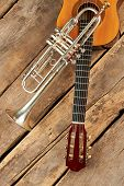 Trumpet And Guitar On Rustic Floor. Acoustic Guitar And Old Trumpet On Wooden Boards, Top View. Retr poster