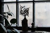 Celestial Globe And A Kerosene Lamp Standing On The Windowsill poster
