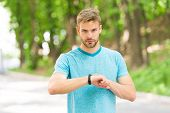 Sportsman Training With Smart Watch. Set Up Fitness Tracker. Fitness Coach. Useful Settings. Wrist B poster