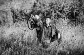 Hunter Friend Enjoy Leisure In Field. Hunters Gamekeepers Looking For Animal Or Bird. Hunting With F poster