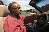 Elderly African American Man Driving Car