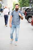 Backpack For Urban Travelling. Hipster Wearing Backpack Urban Street Background. Bearded Man Travel  poster