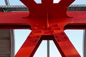 Red Iron Beams Bolted. Asymmetrical Connection Of Several Iron Beams In One Place. poster