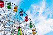 image of ferris-wheel  - Colorful ferris wheel on blue sky background - JPG