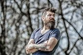 Man Attractive Bearded Hipster Posing Outdoors. Confident Posture Of Handsome Man. Guy Masculine App poster