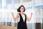 Happy Excited Woman Celebrating Triumph. Joyful Middle Aged Business Lady In Office Hall And Making  poster