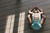 Woman Makes Yoga Position Lying Downand Make Mudra In Yoga Studio. Yoga Practice. poster