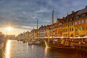 Copenhagen Iconic View. Famous Old Nyhavn Port In The Center Of Copenhagen, Denmark During Sunset poster
