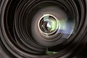 Close Up Of A Television Lens On A Dark Background poster