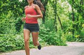 Woman runner on city run marathon race running jogging outdoors in summer active sport lifestyle. He poster
