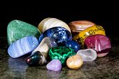 Collection And Mix Of Colorful Trumbled Mineral Stones, Gemstones And Healing Stones poster