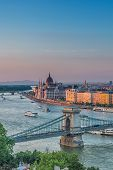 Panorama Of Budapest At Sunset. Hungarian Landmarks: Chain Bridge, Parliament And Danube River In Bu poster