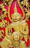 picture of asura  - Golden giant guarding the gate of a Thai ancient temple - JPG