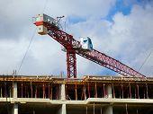 Crane. Self-erection Crane Near Concrete Building. Construction Site. poster
