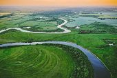 Aerial View Green Meadow And River Landscape In Sunny Spring Evening. Top View Of Beautiful European poster