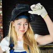 stock photo of people welding  - beautiful smiling blond woman in welder helmet - JPG