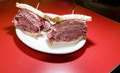 stock photo of deli  - combination tongue corned beef sandwich on seeded rye bread at Jewish deli New York City - JPG