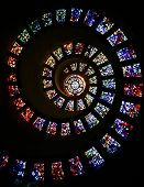 pic of spiral staircase  - Vibrant Stained glass temple spiraling upwards in a circular motion on a black and white background shaped in number 9 - JPG