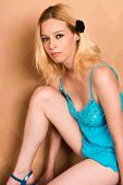 image of nighties  - Pretty blonde woman in a blue nightie - JPG