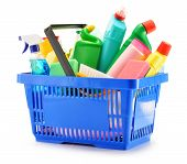 stock photo of disinfection  - Shopping basket with detergent bottles and chemical cleaning supplies isolated on white - JPG
