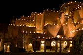 image of luminaria  - In this nighttime shot brightly lit farolitos limn the contours of Santa Fe