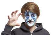stock photo of growl  - Teenage boy with face painting wolf growling on white background - JPG