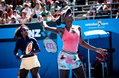 MELBOURNE - JANUARY 22: Venus (R) and Serena Williams of the USA in a doubles match at the 2013 Aust
