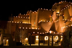 foto of luminaria  - In this nighttime shot brightly lit farolitos limn the contours of Santa Fe