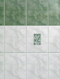 stock photo of ceramic tile  - Detail of green and white tiles in bathroom - JPG