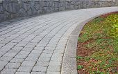 image of paving stone  - Curved stone path with stone wall - JPG