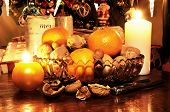 stock photo of hazelnut tree  - Glass bowl filled with walnuts hazelnuts and mandarin oranges with Christmas presents under tree.