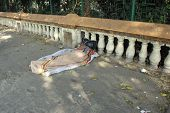 KOLKATA - NOVEMBER 25: Homeless people sleeping on the footpath of Kolkata. on November 25, 2012 in