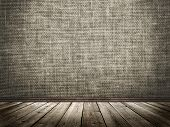 foto of gobelin  - Cloth wall and wooden floor in a grunge style - JPG