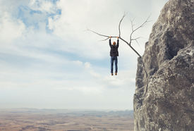 picture of dangerous situation  - Business man climbs a mountain - JPG