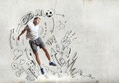 Football player in jump with sketches at background
