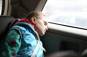 stock photo of seatbelt  - Girl sleeping relaxed and protected in car - JPG