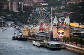 stock photo of funfair  - Luna Park funfair and Milsons Point ferry wharf - JPG
