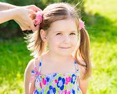 stock photo of ponytail  - Sweet smiling little girl with her mom - JPG