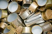 stock photo of reprocess  - Various types of tin cans to be recycled - JPG