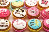 image of eat me  - Different color cakes  on a white background  - JPG