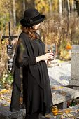 stock photo of snitch  - Young woman in black cloths after husband - JPG