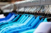 picture of racks  - image of many collared shirts hanging on a rack - JPG