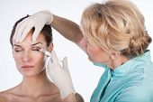 image of forehead  - Doctor injecting in the forehead horizontal  - JPG