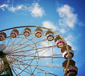picture of carnival ride  -  a fair ride during dusk on a warm summer evening  - JPG