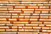 pic of lumber  - Stack of new wooden studs at the lumber yard - JPG