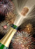 stock photo of happy new year 2013  - champagne with fireworks at holiday like happy new year or birthday - JPG