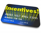 picture of enticing  - Incentives word on a blue credit or gift card for rewards or bonus savings for buying or special performance achievement - JPG