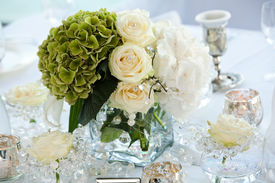 stock photo of wedding table decor  - Table decor with flowers table numbers and candles - JPG